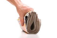 Hand holds a bundle of newspapers Royalty Free Stock Images
