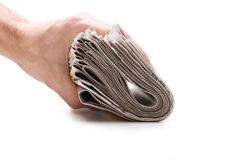 Hand holds a bundle of newspapers Stock Photo