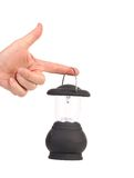 Hand holds camping lantern. Stock Photo