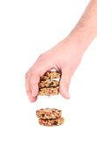 Hand holds candied peanuts sunflower seeds. Stock Photography