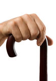 Hand holds a cane isolated Royalty Free Stock Photos
