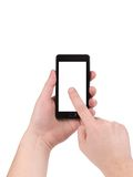 Hand holds cell phone with clipping path. Isolated on a white background Stock Images
