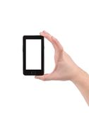 Hand holds cell phone with clipping path. Isolated on a white background Royalty Free Stock Photo