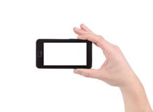Hand holds cell phone with clipping path. Isolated on a white background Stock Photos