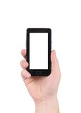 Hand holds cell phone with clipping path. Isolated on a white background Royalty Free Stock Image