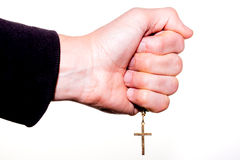 Hand holds a chain with gold crucifix Royalty Free Stock Photos