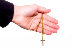 Hand holds a chain with gold crucifix Royalty Free Stock Image