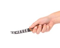 Hand holds cheese knife. Royalty Free Stock Photos