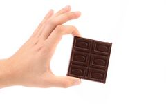 Hand holds chocolate bar. Stock Image