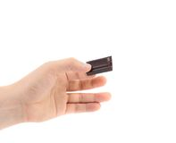 Hand holds chocolate bar. Stock Photography