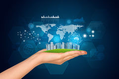 Hand holds city of skyscrapers. World map, Royalty Free Stock Images