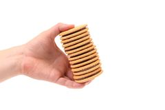 Hand holds closeup cookie biscuits with filling Stock Image