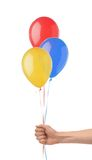Hand holds colorful balloons isolated on white Royalty Free Stock Photo