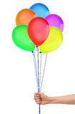 Hand holds colorful balloons isolated on white. Background stock images