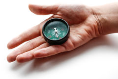 The hand holds a compass. Closeup. Isolated on a white backgroun Stock Images