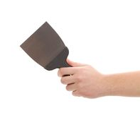Hand holds construction spatula. Royalty Free Stock Photography