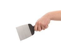 Hand holds construction spatula. Royalty Free Stock Photo