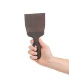 Hand holds construction spatula. Stock Images