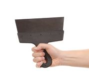 Hand holds construction spatula. Stock Photography