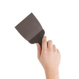 Hand holds construction spatula. Royalty Free Stock Images