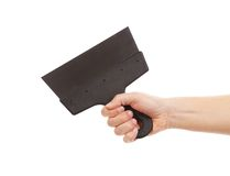 Hand holds construction spatula. Royalty Free Stock Image
