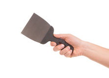Hand holds construction spatula. Royalty Free Stock Photos