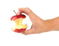 Hand holds core of an apple. Royalty Free Stock Photo