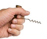 Hand holds corkscrew Stock Image