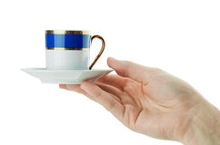 Hand holds cup Royalty Free Stock Photo