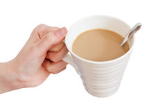 Hand holds cup of coffee with milk Royalty Free Stock Photos