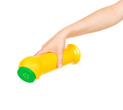 Hand holds detergent bottle Stock Photography