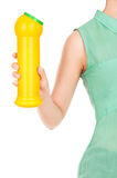 Hand holds detergent bottle. Royalty Free Stock Photo