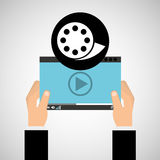 Hand holds digital player film reel Royalty Free Stock Image
