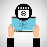 Hand holds digital player movie Royalty Free Stock Images
