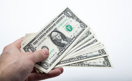 Hand holds a dollar bill Stock Photos