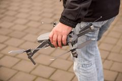 The hand holds the drones of the detachment stock image