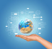 Hand holds Earth with figures and envelopes Royalty Free Stock Photography