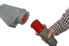 Hand holds electrical plug Royalty Free Stock Photo