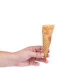 Hand holds empty ice cream cone. Royalty Free Stock Photography