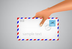 Hand holds the envelope Stock Images