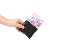 Hand holds euro bills in purse. Royalty Free Stock Image