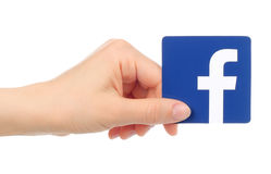 Hand holds Facebook icon stock images