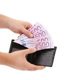 Hand holds five hundred euro from purse. Royalty Free Stock Images