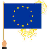 The hand holds the flag of the European Union. Flag of the European Union in hand. Flat design,  illustration Stock Photo