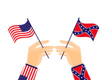 Hand holds the flag of the United States of America and the Confederates. Vector. Illustration Stock Photo