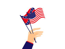 Hand holds the flag of the United States of America and the Confederates. Vector. Illustration Stock Image
