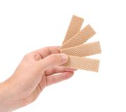 Hand holds of four wafers Royalty Free Stock Photography