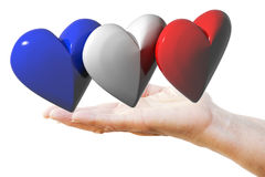 Hand holds french, english, american flag hearts Royalty Free Stock Images