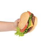 Hand holds fresh hamburger. Stock Images