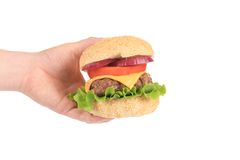 Hand holds fresh hamburger. Stock Photography